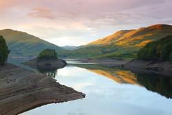 Calm Water at Sunset, Glen Finglas Reservoir, Trossachs, Scotland, UK.