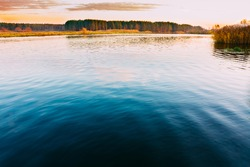 Calm Water Of Lake, River, Forest On Other Side. Landscape. Russian Nature Background.