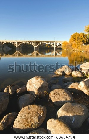 Calm waters of the South Saskatchewan River in Saskatoon, Canada in autumn.