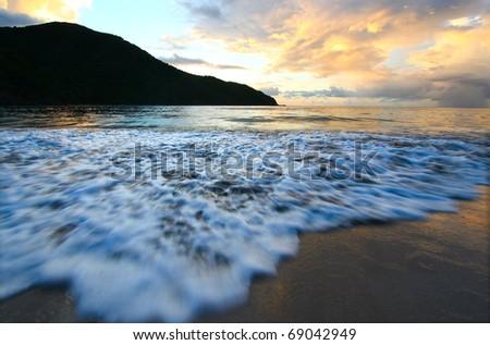 Calm waves wash ashore at Brewers Bay on Tortola - British Virgin Islands