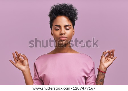 Calm woman relaxing meditating, no stress free relief at work concept, mindful peaceful young businesswoman or student practicing breathing yoga exercises on isolated over lavender background