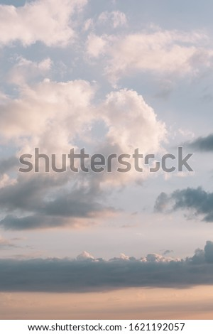 Calming scenic landscape above the sea. Gentle tones of the scenery. Orange and blue tones of sky. Beauty world. Travel and vacation. Natural background concept. Inspirational vertical photo.