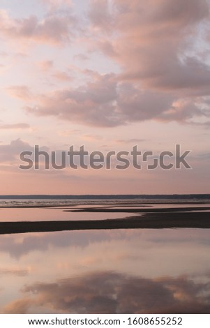 Calming scenic landscape above the sea. Gentle tones of the scenery. Pinky tones of sky. Beauty world. Travel and vacation. Natural background concept. Inspirational vertical photo.
