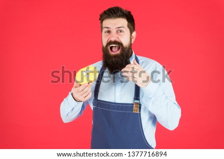 Calorie. Chef feel hunger. Calorie counting. Diet and health. gain calorie. Bearded man in chef apron. Chef man in cafe. Food calorie. baker eat donut. Funny hipster chef. Confident baker. Just baked.