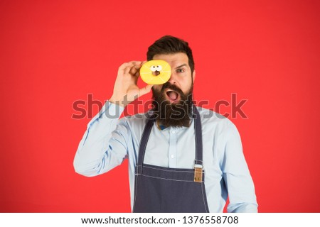 Calorie. Chef feel hunger. Calorie counting. Diet and healthy food. gain calorie. Bearded man in chef apron. Chef man in cafe. Food calorie. baker hold donut. Funny hipster chef. Cook at work.