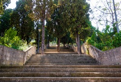 Calvary of Ador. Very long and steep staircase, surrounded by trees, in a park in nature.