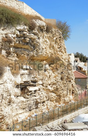 Calvary scenic view and space for text on blue sky. Mystery entombment land site outside archaic city wall. Bluff in form of skull, which suffered terrible torment redeemer of mankind. Middle East