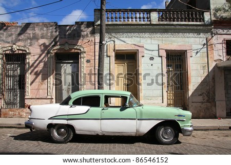 CAMAGUEY, CUBA - FEBRUARY 17: Classic American car parked in the street on February 17, 2011 in Camaguey, Cuba. The multitude of oldtimer cars in Cuba is its major tourism attraction.