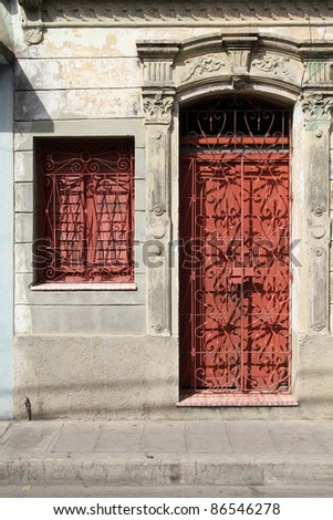 Camaguey, Cuba - old town listed on UNESCO World Heritage List. Ornate door - colonial architecture.