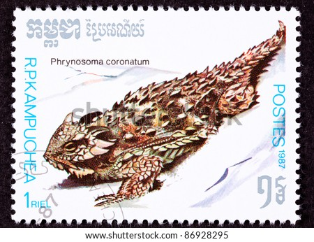 CAMBODIA - CIRCA 1987:  A stamp printed in Cambodia shows a Coast Horned Lizard, Phrynosoma coronatum, is often called a horny toad.  It can shoot blood from eyes when attacked, circa 1987.