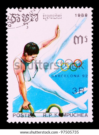 CAMBODIA - CIRCA 1989: The postal stamp printed in CAMBODIA shows gymnastics, series Olympic Games in Barcelona 1992, circa 1989