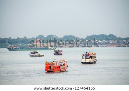 Cambodia, Phnom Penh, boats on Mekong river - stock photo