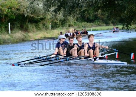 CAMBRIDGE, CAMBRIDGESHIRE, ENGLAND, UK - OCTOBER 13, 2018: Competitors of the Rob Roy Boat Club Autumn Head Boat Race on the River Cam. #1205108698