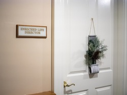 Cambridge, USA - December 2 2017: Entrance to an enriched life director's office in an old people's home