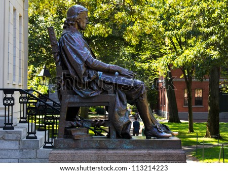 CAMBRIDGE, USA - SEPTEMBER 14, 2012: John Harvard's statue in the Harvard's campus in Cambridge, MA, is the third most photographed monument in the USA. Photographed as it is on September 14, 2012. - stock photo