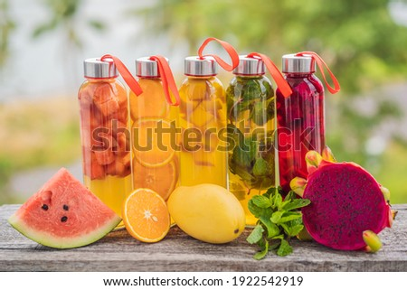 Cambucha with various fruits arranged in the form of a rainbow. Homemade fermented raw kombucha tea with different flavorings. Healthy natural probiotic flavored drink. LGBT Stock photo ©