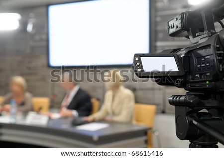 Camcorder at a news conference.