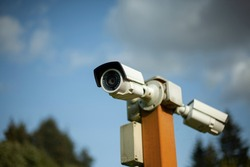 Camcorders on the pole. Security system. Outdoor surveillance video camera. Protected area. Perimeter security is protected by cameras with motion sensors.
