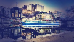 Camden lock with a canal boat moored with a instagram type filter