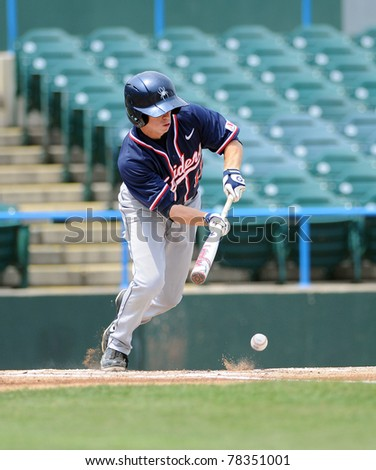 CAMDEN, NJ - MAY 26: Richmond batter Matt Zink bunts, the ball hitting just in front of the plate,  during an Atlantic Ten baseball tournament game against Charlotte May 26, 2011 in Camden, NJ.