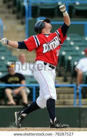 CAMDEN, NJ - MAY 25: University of Dayton batter C.J. Gilman follows the flight of a ball he has hit during an Atlantic 10 tournament game against LaSalle on May 25, 2011 in Camden, NJ.