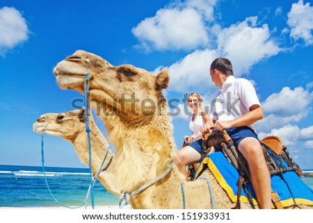 camel ride on wedding day (focus on face of bride)