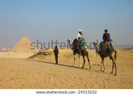 Camel ride to pyramids