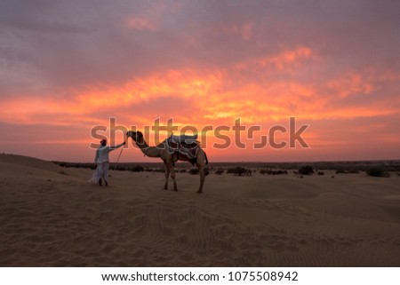 camel trader crossing the sand...