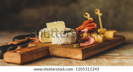 camembert cheese (cheese platter delicacies) groceries. Brie cheese top view.