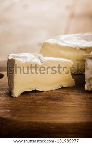 camembert cheese slice macro shot. Shallow DOF