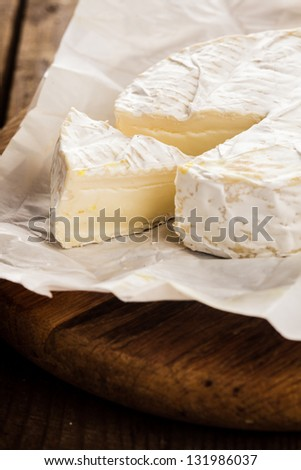 camembert cheese slice macro shot. Shallow DOF