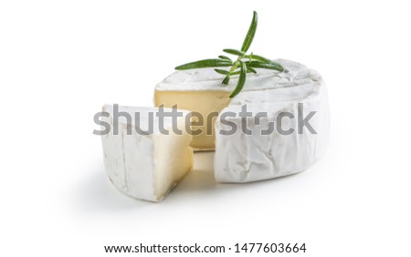Camembert or brie cheese with rosemary isolated on white. Сток-фото ©