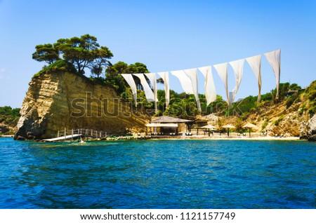 Cameo island at sunny day. Famous beach inside the bay of Cameo island near Zakynthos, Greece #1121157749