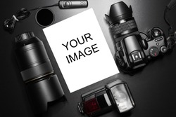 Camera equipment around a printed photo (copy-space to insert your image) - In this photo the logos, brand, or anything that can bring to a particular object has been deleted to be 100% commercial.