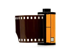Camera film roll cartridge or 35mm filmstrip.equipment for photograph on white background.