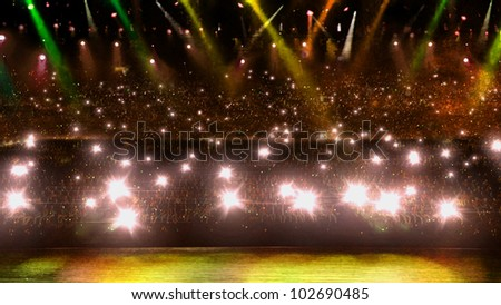 camera flash in concert with yellow spotlight