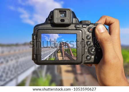 Camera in hand shooting two bridges in a state line between Arizona and California