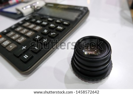 Camera Lens Choosing conceptual,len price calculation.