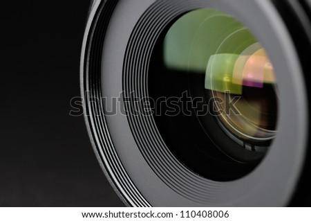 Camera lens close-up on black background