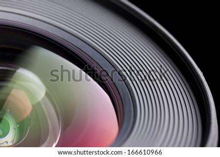 Camera lens close-up on black background