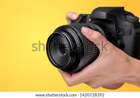 Camera lens with lens reflections on background.