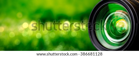 Stock Photo Camera lens with lense reflections.