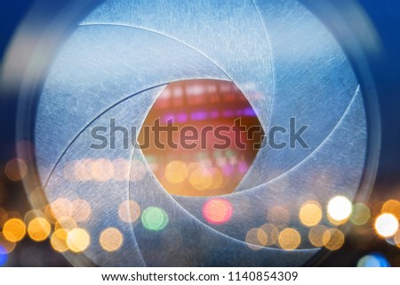 Camera lens with lense reflections. Open aperture objective close-up. Media and technology concept background. Macro shot.