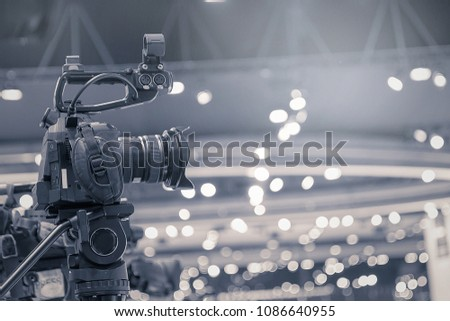 Camera man making film captures in the events hall on stage live television broadcast and recording.
