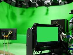 camera monitor of professional studio camera with virtual greenscreen at TV station.