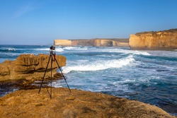 Camera on a tripod ready to shoot a landscape scenery at Loch Ard Gorge, part of Port Campbell National Park, Victoria, Australia. Camera in image is a Canon.
