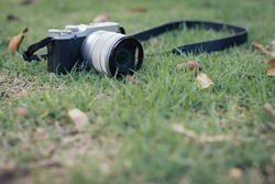Camera on the grass background.