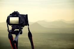 Camera on tripod Photographers take scenic views.