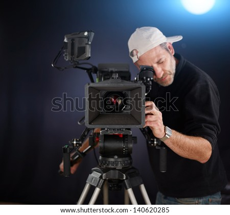camera operator working with a cinema camera - stock photo