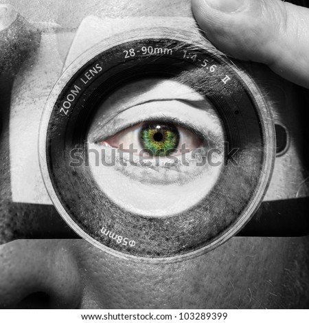Camera painted on male face with green eyes